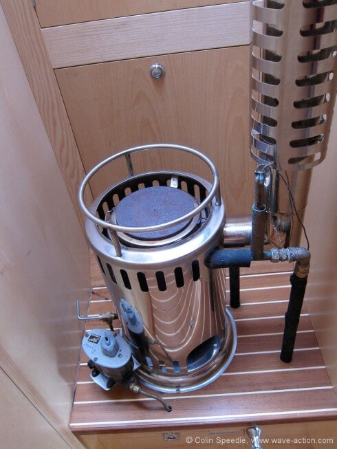 The Danish Refleks stove is fitted just ahead of the galley in its own recess - the heart of the boat!