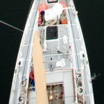 A view of the deck of aluminum sailboat Morgan's Cloud taken from the top of the mast, showing the Treadmaster deck covering.