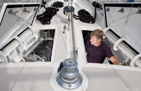 """The whole forward end of the boat is given over to a massive storage locker that can swallow up dinghy, outboard, spare anchors, two large line reels and just about everything else required for aggressive high latitude cruising. Michael and Martina believe, as we do, that the deck should be completely cleared before going to sea. For that reason """"Polaris"""", like """"Morgan's Cloud"""", does not have a rigid bottom dinghy since that would preclude stowing it below."""