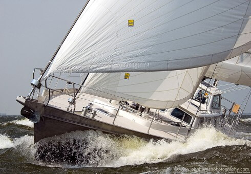 """The 54-foot Hutting (Dutch) built custom cutter """"Polaris"""" shows her power on a blustery day. Courtesy of Michael Haferkamp"""