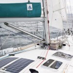 OVNI 435 Pèlerin under sail with a boom brake from Wichard called Gyb'easy in use.