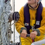 Phyllis hoists the mainsail on aluminum expedition sailboat Morgan's Cloud.