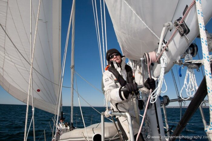 Phyllis repeats steps 4 and 6 until the reef tack gets to the boom end and the reef cringle nearly so. She is in no hurry since the sail is not flapping and banging and she is not getting wet, as she would be if we had rounded up.